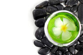 Zen stones and White frangipani flower with text space isolated — Stock Photo