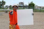 Angry oil and gas asian worker with blank sign, ready for your t — ストック写真