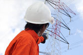 Men working at electricity main power pole — Stock Photo
