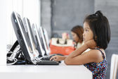 Little girl playing computer — Stock Photo