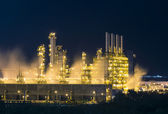 Night scene of vapour stream in industrial plant — Stock Photo
