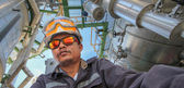 Engineer in refinery plant — Stock Photo