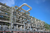 Structure with piping in refinery plant — Stock Photo