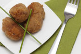 Croquettes on white plate — Stock Photo