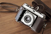 Old-fashioned film photocamera — Stock Photo