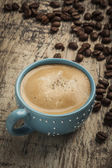 Coffee with coffee beans — Stock Photo