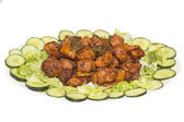 Spicy chicken tikka served in a tray with lettuce — Stock Photo