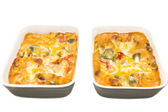 Two dishes of baked pasta isolated on white background — Stock Photo