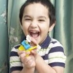 Portrait of happy cute little boy laughing hard — Stock Photo #27100231