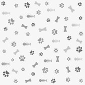 Background with dog paw print and bone — Stock Vector