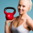 Stock Photo: Girl and kettlebell