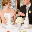 Bride and groom toasting — Stock Photo #19545677