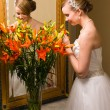 Stock Photo: Bride and flowers
