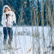 Stock Photo: Womand snowshoes