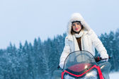 Woman and snowmobile — Stock Photo