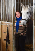 Woman and horse — Stockfoto