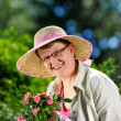 Woman and flowers — Stock Photo #26740599