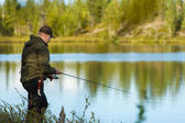 Fisherman and landscape — Stock Photo