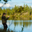Fisherman and landscape — Stockfoto