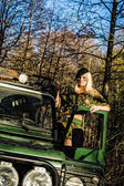 Girl and off-road vehicle — Stockfoto