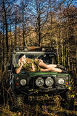 Girl and off-road vehicle — Stock Photo