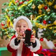 Boy and Christmas gift — Stock Photo #34939487