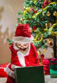 Boy and Christmas gift — Stock Photo