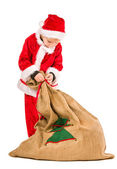 Boy and Christmas sack — Stock Photo