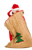 Boy and Christmas sack — Stock fotografie