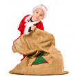 Boy and Christmas sack — Stockfoto