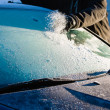 Stock Photo: Cleans frozen windshield