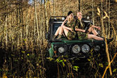 Girls and off-road vehicle — Stock Photo