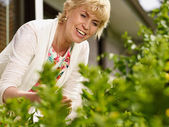 Woman and plants — Foto Stock
