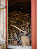 Axe and woodpile — Stock Photo