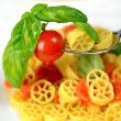 Wheels of pasta with fresh tomatoes — Photo
