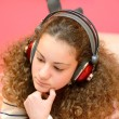 Girl listening to music on the computer — ストック写真