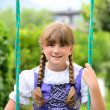 Little girl on the swing — Stock Photo
