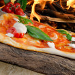 Wood-fired pizzas — Stock Photo