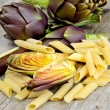 Artichokes on wooden table — Stock Photo #40862251
