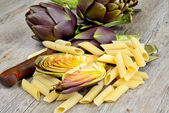 Artichokes on wooden table — Stock Photo