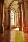 Aged interior of caserta palace — Stock Photo