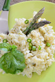 Rice by asparagus cream — Stock Photo