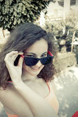 Girl and sunglasses — Stock Photo