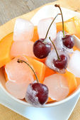 Ice cube cherries — Stock Photo