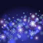 Blå bakgrund med snöflingor. — Stockvektor