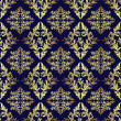 Luxury seamless ornamental Wallpaper: gold on dark blue. — Stock Vector #40548197