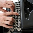 Typing on a vintage typewriter — Stock Photo