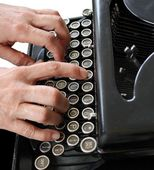 Typing on a vintage typewriter — Stok fotoğraf
