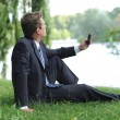 Businessman having a break in the park — Stock Photo