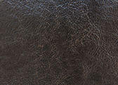 Black textured leather background — Stok fotoğraf